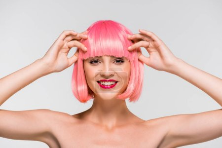 Photo for Beautiful naked girl in pink wig isolated on grey - Royalty Free Image