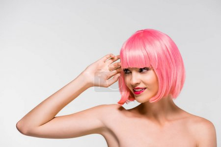 Photo for Fashion Shoot with attractive naked girl in pink wig isolated on grey - Royalty Free Image