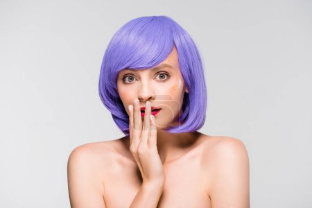 Photo for Surprised attractive girl in purple wig isolated on grey - Royalty Free Image