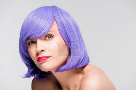 Photo for Pretty thoughtful girl in purple wig isolated on grey - Royalty Free Image