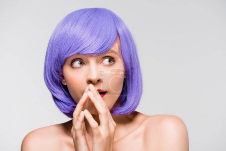 Photo for Pretty shocked girl in purple wig isolated on grey - Royalty Free Image