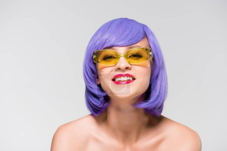Photo for Beautiful smiling girl in purple wig and trendy sunglasses isolated on grey - Royalty Free Image