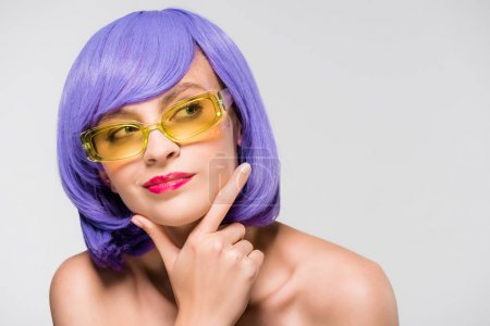 Photo for Beautiful thoughtful girl in purple wig and sunglasses isolated on grey - Royalty Free Image