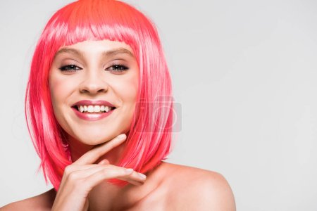 Photo for Attractive smiling young woman in pink wig isolated on grey - Royalty Free Image