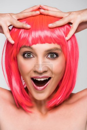 Photo for Stylish excited woman in pink wig isolated on grey - Royalty Free Image