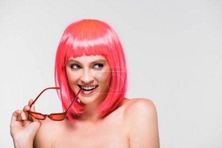Foto de Fashionable woman in pink wig and sunglasses isolated on grey - Imagen libre de derechos