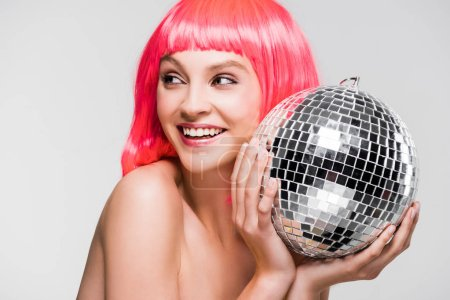 Photo for Attractive girl in pink wig holding disco ball, isolated on grey - Royalty Free Image