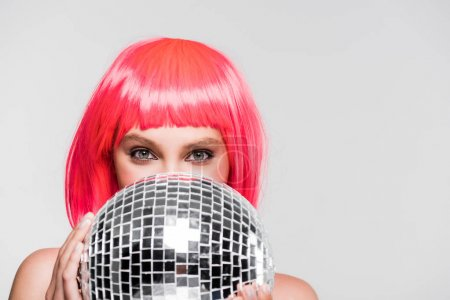 Photo for Beautiful girl in pink wig holding disco ball, isolated on grey - Royalty Free Image