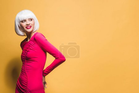 Photo for Pretty smiling girl in white wig isolated on yellow - Royalty Free Image