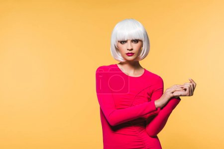 Photo for Attractive young woman in white wig isolated on yellow - Royalty Free Image