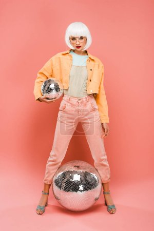 Photo for Beautiful stylish girl in white wig posing with disco balls on pink - Royalty Free Image