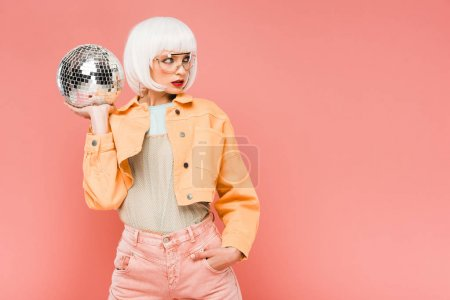 Photo for Beautiful stylish woman in white wig posing with disco ball, isolated on pink - Royalty Free Image