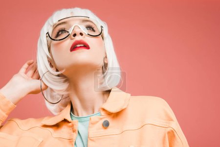 Photo for Fashionable woman posing in sunglasses and white wig isolated on pink - Royalty Free Image