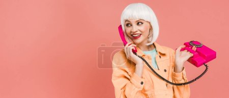Foto de Beautiful stylish woman in white wig talking on retro telephone, isolated on pink - Imagen libre de derechos