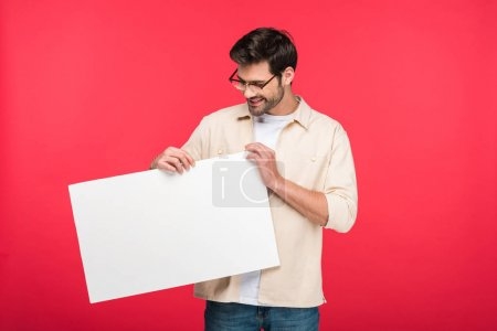 Photo for Smiling handsome man holding empty board Isolated On pink - Royalty Free Image