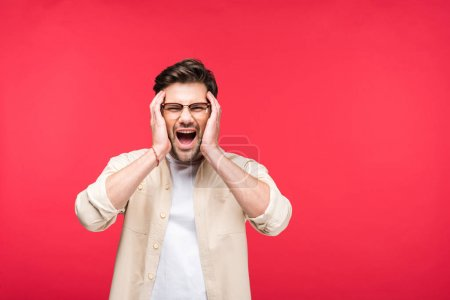 Photo for Handsome man with Hands on head screaming Isolated On pink - Royalty Free Image