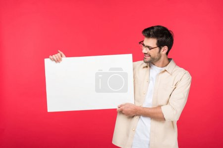 Photo for Handsome man holding empty board Isolated On pink - Royalty Free Image