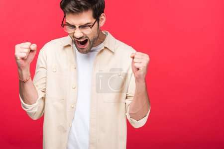 Photo for Excited handsome man with clenched fists Isolated On pink - Royalty Free Image