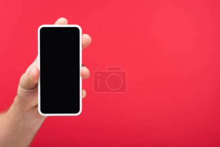 Photo for Cropped view of man holding smartphone with blank screen Isolated On pink - Royalty Free Image