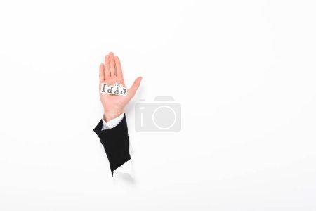 Photo pour Vue cultivée de papier de fixation d'homme avec le mot d'idée du trou dans le mur sur l'espace blanc avec l'espace de copie - image libre de droit