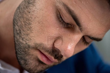Photo for Handsome exhausted man with sweaty face suffering from heat on grey - Royalty Free Image