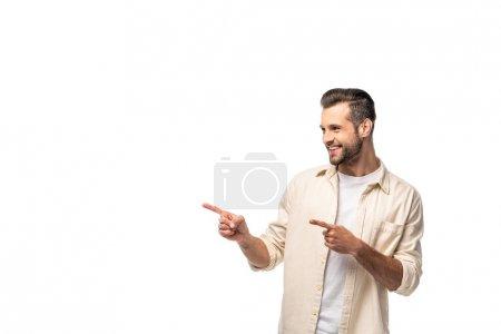Photo pour Homme heureux pointant avec les doigts isolé sur blanc avec espace de copie - image libre de droit