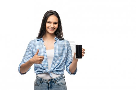 Photo for Happy girl with thumb up sign showing smartphone with blank screen Isolated On White - Royalty Free Image