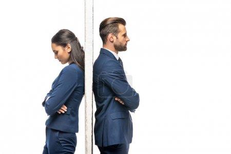 Photo pour Bouleversé homme d'affaires et femme d'affaires séparés par mur isolé sur blanc - image libre de droit