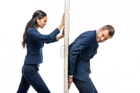 Photo for Businessman and businesswoman in suits pushing wall isolated on white - Royalty Free Image