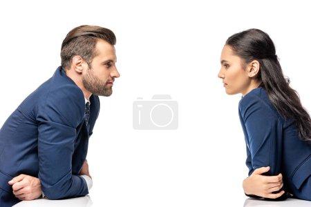 Foto de Hombre de negocios y empresaria en ropa formal mirando a los demás aislados en blanco - Imagen libre de derechos