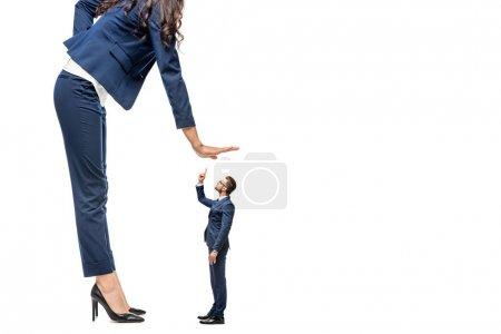 Photo pour Big businesswoman showing stop sign near small businessman Isolated On White - image libre de droit