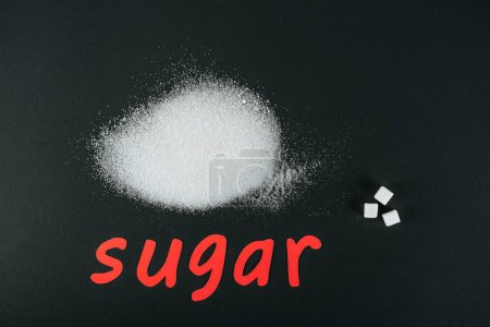 Photo for Top view of white sugar crystals and cubes near red paper cut word sugar on black background - Royalty Free Image