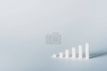 Foto de White sugar cubes arranged in stacks on grey background with copy space - Imagen libre de derechos