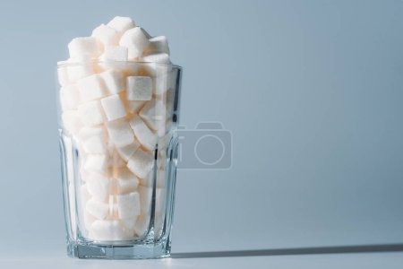 Photo for White sugar cubes in glass on grey background with copy space - Royalty Free Image