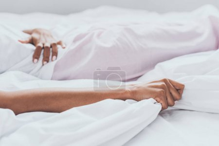 Photo for Partial view of african american woman lying in bed and suffering from abdominal pain - Royalty Free Image