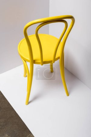 Photo for Yellow comfortable chair on white and grey with copy space - Royalty Free Image