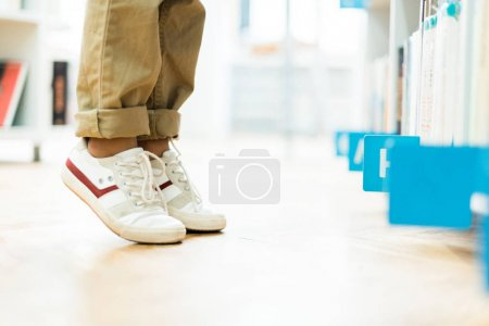 Photo for Cropped view of kid standing on tip toe in white sneakers - Royalty Free Image