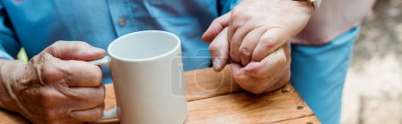 Photo pour Panoramic shot of man holding hands with retired wife - image libre de droit