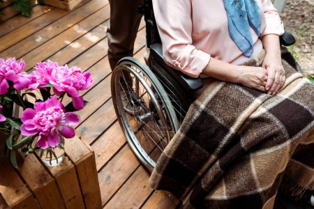 Photo for Cropped view of disabled senior woman sitting in wheelchair - Royalty Free Image