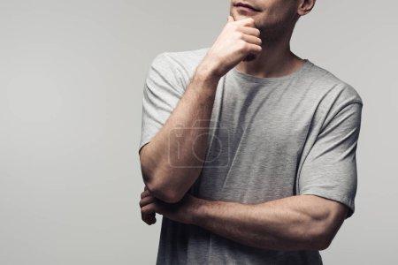 Photo pour Vue partielle de la main réfléchie de fixation d'homme près du visage d'isolement sur le concept gris, d'émotion et d'expression humaine - image libre de droit