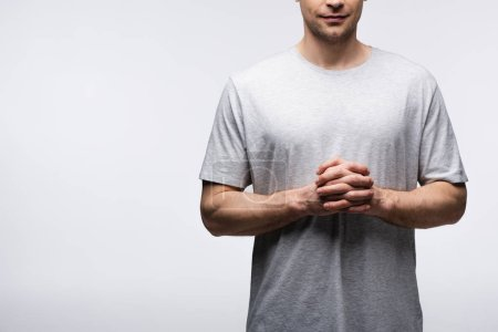 Photo for Partial view of man standing with clenched hands isolated on grey, human emotion and expression concept - Royalty Free Image
