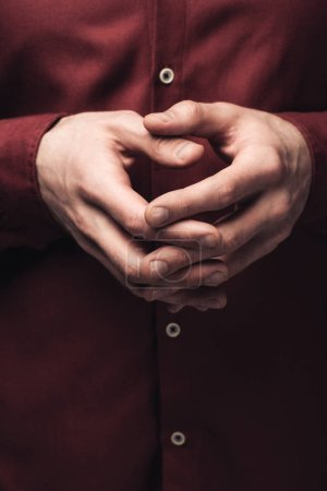 Photo pour Partial view of man gesturing with clenched hands, human emotion and expression concept - image libre de droit