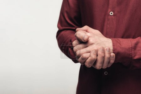 Photo for Partial view of man with clenched hands using body language isolated on grey, human emotion and expression concept - Royalty Free Image