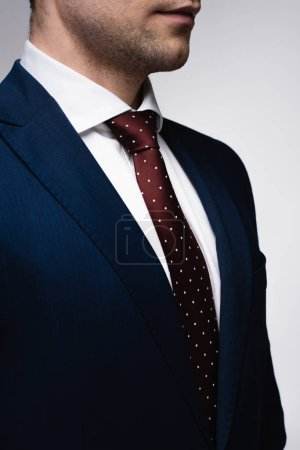 Photo for Partial view of confident businessman in suit and tie isolated on grey - Royalty Free Image