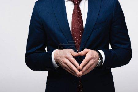 Photo pour Vue partielle de l'homme d'affaires confiant affichant le geste de clocher isolé sur le concept gris, humain d'émotion et d'expression - image libre de droit