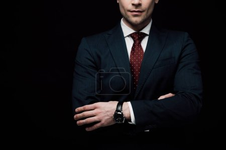 Photo for Partial view of businessman standing with crossed arms isolated on black - Royalty Free Image