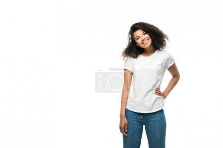 Photo for Happy african american girl in white t-shirt standing with hand on hip isolated on white - Royalty Free Image