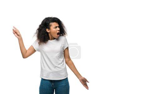 Photo pour Surpris frisé afro-américain femme pointant avec doigt isolé sur blanc - image libre de droit