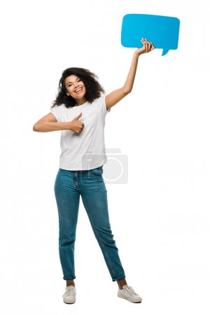 happy african american girl holding blue speech bubble and showing thumb up isolated on white