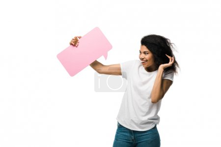 happy african american girl looking at pink speech bubble isolated on white
